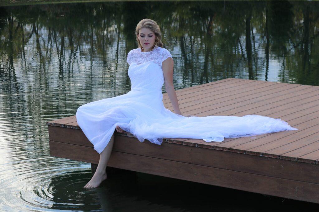 Bride sits on dock