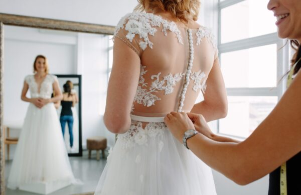 trying on a wedding dress