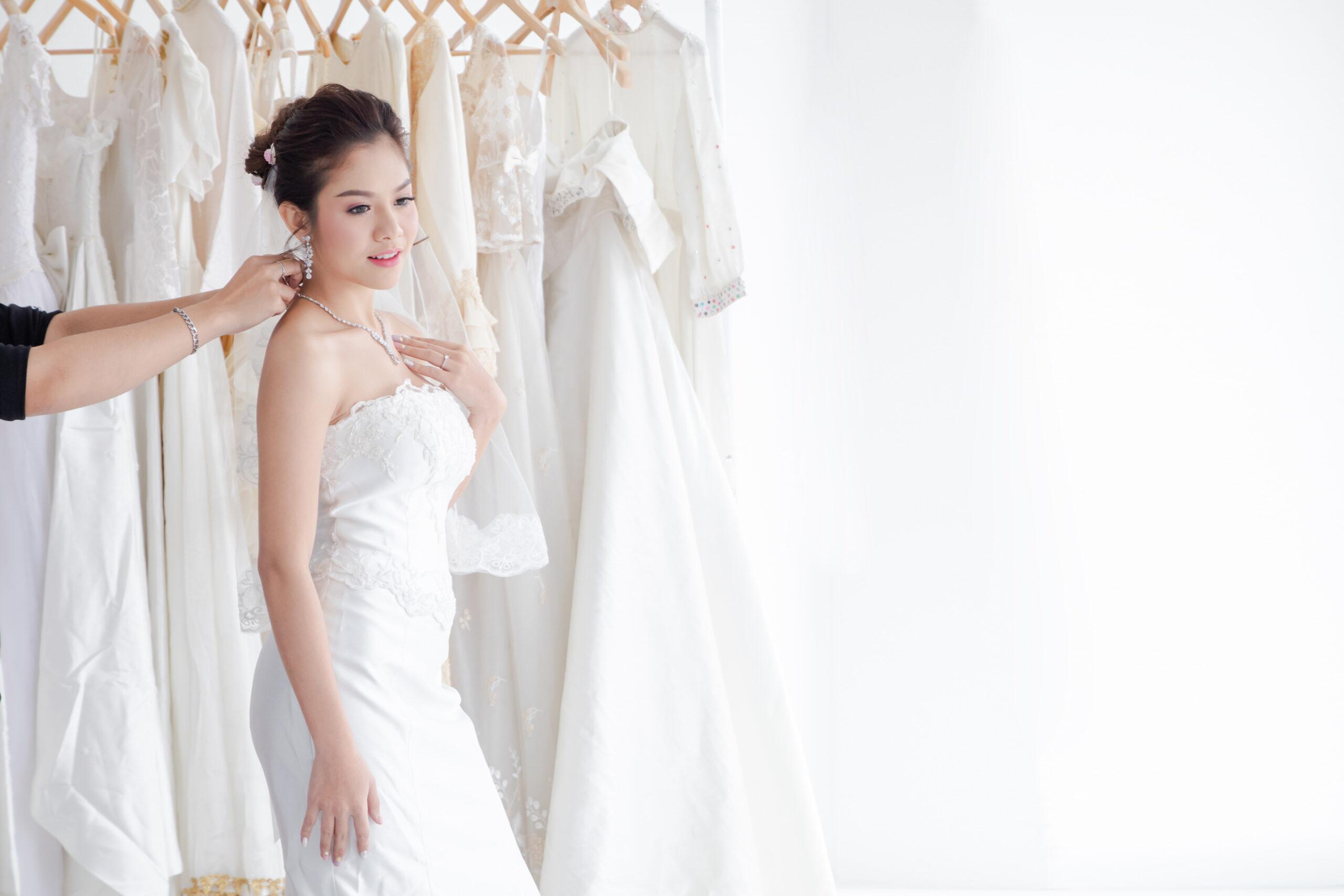 Bride tries on wedding dress